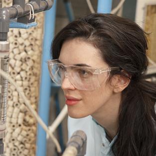 student examining microscope