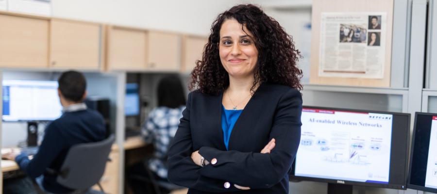 Professor Melike Erol-Kantarci standing in computer lab