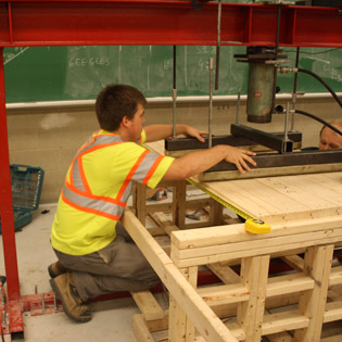 student using machinery