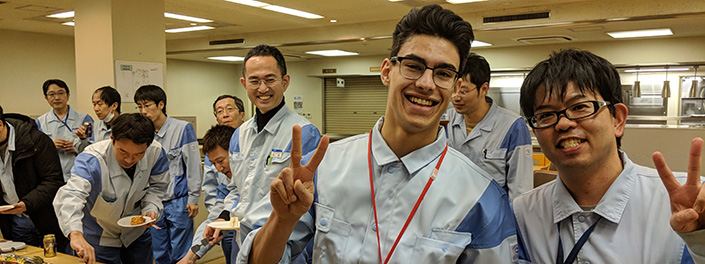 CO-OP student Sheldon Harrison (centre) with colleagues at Dai Nippon Printing Co. Ltd., Chiba, Japan.