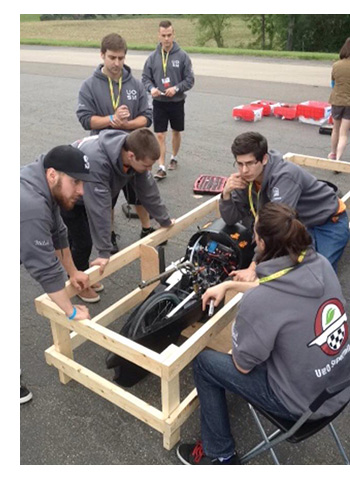 students working on race car
