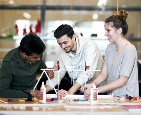 Some students building a prototype