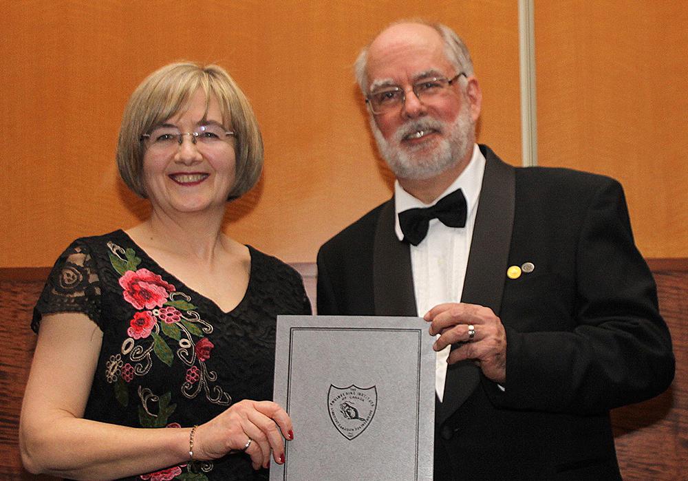 F. Handan Tezel receiving her award