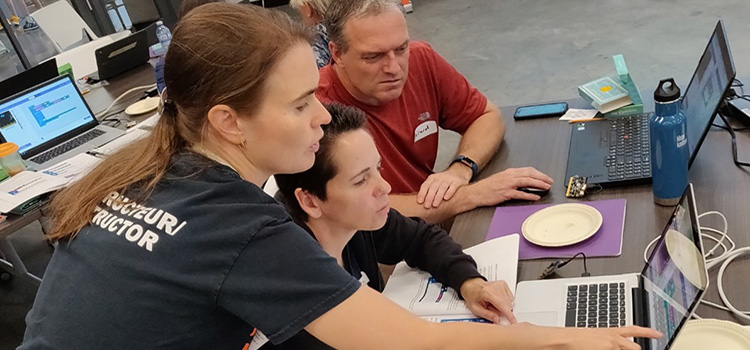 Instructor helping Teachers with Scratch