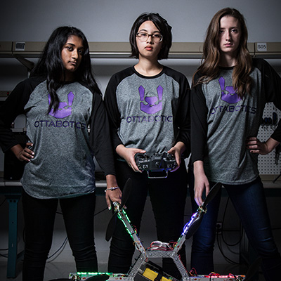 Three students in the robotics team.