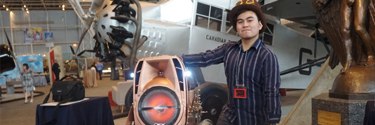 student showing off his Steampunk project