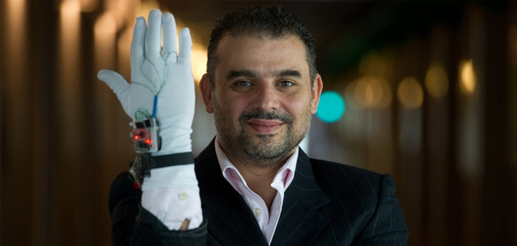 Dr. Abdulmotaleb El Saddik with a smart tech device